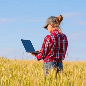 farmer looking at her computer