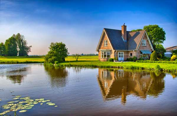 rural home next to a pond
