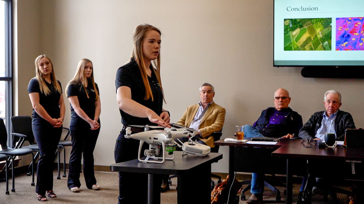 Kacie Timmons, Student Board discusses the drone project.